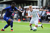Dynel Simeu of Chelsea battles with Marc Walsh of Swansea City in action during the Premier League u18 match between Swansea City AFC and Chelsea FC at Landore Training Ground, Wales, UK. Tuesday 11th September 2018