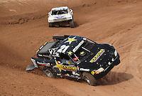 Dec. 10, 2010; Chandler, AZ, USA;  LOORRS pro two unlimited driver Rob MacCachren (21) goes on two wheels during qualifying for round 15 at Firebird International Raceway. Mandatory Credit: Mark J. Rebilas-