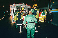 Paramedic, firefighters and police officers attend a road traffic accident in which the driver was trapped in the vehicle. The paramedics attended to his injuries whilst the firefighters removed the roof using hydraulic cutting equipment. They finally released him and can be seen putting him into the back of an ambulance on a stretcher. They have placed an oxygen mask and a neck brace on the casualty.  ..© SHOUT. THIS PICTURE MUST ONLY BE USED TO ILLUSTRATE THE EMERGENCY SERVICES IN A POSITIVE MANNER. CONTACT JOHN CALLAN. Exact date unknown.john@shoutpictures.com.www.shoutpictures.com..