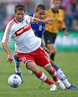 Chicago Fire midfielder Logan Pause (7) dribbles the ball out of trouble.  The Chicago Fire defeated English Premier League Team Everton FC 2-0 in a friendly match at Toyota Park in Bridgeview, IL, on July 30, 2008.