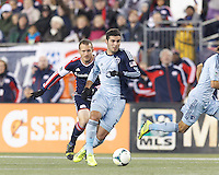 Sporting Kansas City substitute forward Soony Saad (22) on the attack as New England Revolution substitute midfielder Chad Barrett (9) closes. In the first game of two-game aggregate total goals Major League Soccer (MLS) Eastern Conference Semifinal series, New England Revolution (dark blue) vs Sporting Kansas City (light blue), 2-1, at Gillette Stadium on November 2, 2013.