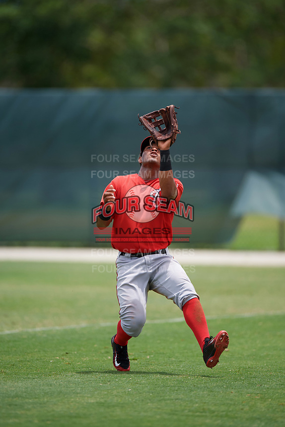 GCL Nationals right fielder Santo Falcon (17) catches a fly ball during the second game of a doubleheader against the GCL Marlins on July 23, 2017 at Roger Dean Stadium Complex in Jupiter, Florida.  GCL Nationals defeated the GCL Marlins 1-0.  (Mike Janes/Four Seam Images)