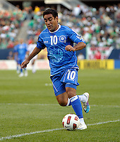 El Salvador's Eliseo Quintanilla dribbles toward the Cuba goal.  El Salvador defeated Cuba 6-1 at the 2011 CONCACAF Gold Cup at Soldier Field in Chicago, IL on June 12, 2011.