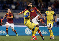Calcio, Serie A: Roma vs Chievo Verona, Stadio Olimpico, , 7 maggio  2013..ChievoVerona midfielder Isaac Cofie, of Ghana, foreground, and AS Roma forward Erik Lamela, of Argentina, fight for the ball during the Italian serie A football match between Roma and ChievoVerona at Rome's Olympic stadium, 7 maggio  2013..UPDATE IMAGES PRESS/Isabella Bonotto