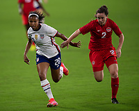 ORLANDO CITY, FL - FEBRUARY 18: Margaret Purce #20 runs after a ball while pressured by Allysha Chapman #2 during a game between Canada and USWNT at Exploria stadium on February 18, 2021 in Orlando City, Florida.