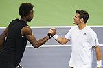 SHANGHAI, CHINA - OCTOBER 13:  aul-Henri Mathieu of France congratulates his compatriot Gael Monfils after loosing the match during day three of 2009 Shanghai ATP Masters 1000 at the Qi Zhong Tennis Centre in Shanghai. Photo by Victor Fraile / The Power of Sport Images