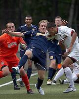 Quinnipiac University defender Matthew Rothbart (14) corner kick defense. Boston College defeated Quinnipiac, 5-0, at Newton Soccer Field, September 1, 2011.
