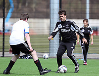 Thursday 11 April 2013<br /> Pictured: Michael Laudrup (R) against.<br /> Re: Friendly game, Swansea City FC coaching staff v sports reporters at the Swansea City FC training ground. Final score 10-4.