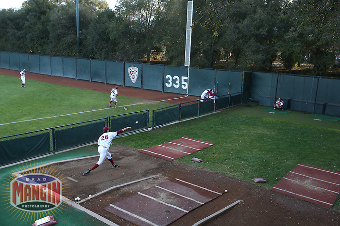 PALO ALTO - MARCH 8:  Mark Appel of Stanford University warms up before the game against UNLV at Sunken Diamond on March 8, 2013 in Palo Alto, California. (Photo by Brad Mangin)