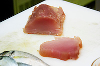 Gruissan village. La Clape. Languedoc. Restaurant La Cranquette. Tuna fish cut in slices on a cutting chopping board. France. Europe.