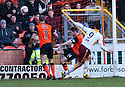 Motherwell's John Sutton thinks he's scores their first goal as Dundee Utd's Callum Morris clears. Referee Craig Thomson gave the goal before chalking it off after consulting his stand side assistant.