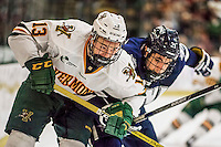 10 February 2017: University of Vermont Catamount Forward Liam Coughlin, a Sophomore from South Boston, MA, works against University of New Hampshire Wildcat Defenseman Anthony Wyse, a Freshman from Newton, MA, in the second period at Gutterson Fieldhouse in Burlington, Vermont. The Catamounts fell to the Wildcats 4-2 in the first game of their 2-game Hockey East Series. Mandatory Credit: Ed Wolfstein Photo *** RAW (NEF) Image File Available ***