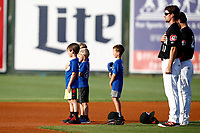 Ryan Walker (11) and Alex Perez (2) of the Chattanooga Lookouts along with some local youth ball players stand in the center of the field during the playing of the National Anthem at AT&T Field on May 23, 2018 in Chattanooga, Tennessee. (Andy Mitchell/Four Seam Images)