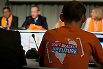 A young person listens to Yvo de Boer speak at the Intergenerational Inquiry. On his t-shirt is a message to negotiators to not bracket the future of youth. (Images free for Editorial Web usage for Fresh Air Participants during COP 15. Credit: Robert vanWaarden)