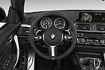 Car pictures of steering wheel view of a 2017 BMW 2-Series M230i 2 Door Convertible Steering Wheel
