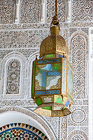 Fes, Morocco.  Lantern Hanging in the Zaouia of Moulay Idris II, Stucco Decoration on the Walls.  Fes El-Bali.