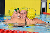 Leiston Pickett, Sally Hunter and Lorna Tonks of AUS celebrate at the conclusion of 100 meter breaststroke final during Commonwealth Games Swimming, Monday, July 28, 2014 in Glasgow, United Kingdom. (Mo Khursheed/TFV Media via AP Images)