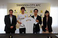 Friday 02 November 2012<br /> Pictured L-R: vice chairman Leigh Dineen, Footballer Ki Sung Yueng and representatives from Nexon.<br /> Re: Sponsorship deal between Korean gaming firm Nexon and Swansea City FC at the Liberty Stadium, south Wales.
