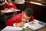 K-8 Parochial School Bronx New York Grade 4 boy writing in class horizontal