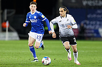 (L-R) Harry Wilson of Cardiff City and Yan Dhanda of Swansea City in action during the Sky Bet Championship match between Swansea City and Cardiff City at the Liberty Stadium, Swansea, Wales, UK. Saturday 20 March 2021