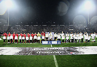 Pictured: Match officials, team captains and children mascots line up before the game was abandoned at Toumba Stadium in Thessaloniki, Greece. Sunday 25 February 2018<br /> Re: Sunday's Greek Super League derby between PAOK Thessaloniki and Olympiakos was called off after Olympiakos' manager Oscar Garcia was struck in the face by an object believed to be a till machine paper roll, thrown by a spectator minutes before kick-off.<br /> Garcia left Toumba Stadium for a local hospital to seek treatment for a bloodied lip.<br /> The incident prompted the Olympiakos team to leave the pitch in protest before riots erupted outside the ground.<br /> Angry PAOK fans leaving the stadium then clashed with police who used tear gas to quell the violence.