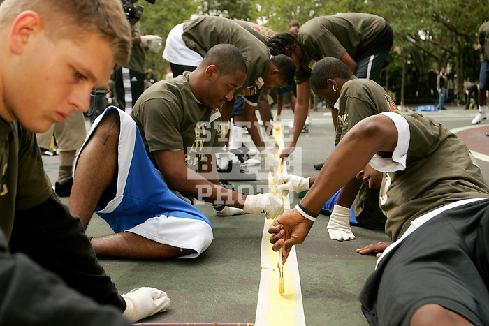 High school basketball standouts paint a line on a basketball court in New York City as part of their volunteer service on August 31, 2006.  The players were in town for the Elite 24 Hoops Classic, which brought together the top 24 high school basketball players in the country regardless of class or sneaker affiliation.