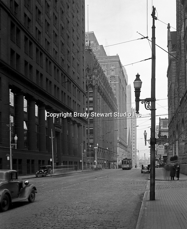 Pittsburgh PA:  View North at the corner of Diamond and Grant Streets.  The Frick Building is on the left and City-County Building on the right.
