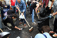 People from the local community get together to start to clean up the streets in the London borough of Hackney. London saw the beginnings of riots on Saturday evening, after a peaceful protest in response to the shooting by police of Mark Duggan during an attempted arrest, escalated into violence. By the third night of violence, rioting and looting had spread to many areas of the capital and to other cities around the country.