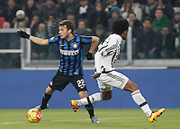 Calcio, semifinali di andata di Coppa Italia: Juventus vs Inter. Torino, Juventus Stadium, 27 gennaio 2016.<br /> FC Inter's Adem Ljajic, left, is chased by Juventus' Juan Cuadrado during the Italian Cup semifinal first leg football match between Juventus and FC Inter at Juventus stadium, 27 January 2016.<br /> UPDATE IMAGES PRESS/Isabella Bonotto
