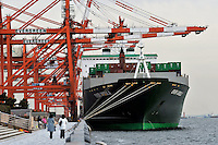 Containers are loading to a ship, ready for export at the Port of Tokyo in Japan. Industrial production in Japan plunged at the steepest pace in 55 years in the fourth quarter, and unemployment rose at the fastest rate in 41 years with exports in the third quarter were a record 13.9 per cent lower than in the previous quarter..19 Feb 2009