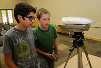 STAFF PHOTO FLIP PUTTHOFF <br /> Ervin Serrano, left, and Colin Conway on June 17 2014 look over a camera that records ultraviolet and infrared light.