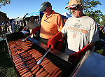 Ron Waicul, left, and Lee Pisiewski, with the Carson City Elks Lodge, cook 2,500 hot dogs at the 14th annual National Night Out in Carson City, Nev., on Tuesday, Aug. 2, 2016. <br />