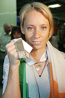 2/8/2010. Derval O'Rourke arrives back into Dublin Aiorport. European silver-medallist Derval O'Rourke has arrived home from Barcelona.O'Rourke finished second in the 100m hurdles on Saturday night to win her second European Athletics Championship silver medal. She was presented with her medal at the Olympic Stadium in Barcelona yesterday evening. Picture James Horan/Collins Photos