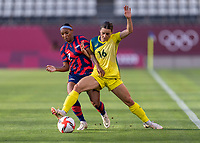 KASHIMA, JAPAN - AUGUST 5: Crystal Dunn #2 of the USWNT fights for the ball with Hayley Raso #16 of Australia during a game between Australia and USWNT at Kashima Soccer Stadium on August 5, 2021 in Kashima, Japan.
