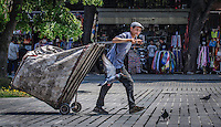 Urban Street Photograph of one of the many private garbage collectors in Istanbul Turkey.