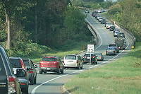 ALTERED STATE PHOTO ESSAY/ANDREW SHURTLEFF<br /> Traffic backs up on the John Warner Parkway.<br /> <br /> Shut downs and stay-in-place orders, the most recent of which came from Gov. Ralph Northam Monday, have left Charlottesville dormant. Students have been sent home, many businesses have shut their doors and events have been canceled. In this photo essay, photographer Andrew Shurtleff has spent time capturing the effects of the pandemic and comparing the duality of the present with our social past.