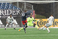 FOXBOROUGH, MA - NOVEMBER 1: Teal Bunbury #10 of New England Revolution shoots his second goal of the night during a game between D.C. United and New England Revolution at Gillette Stadium on November 1, 2020 in Foxborough, Massachusetts.