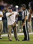 Nevada Head Coach Brian Polian argues with an official during the second half of an NCAA college football game against Boise State, in Reno, Nev., on Saturday, Oct. 4, 2014. Boise State won 51-46. (AP Photo/Cathleen Allison)