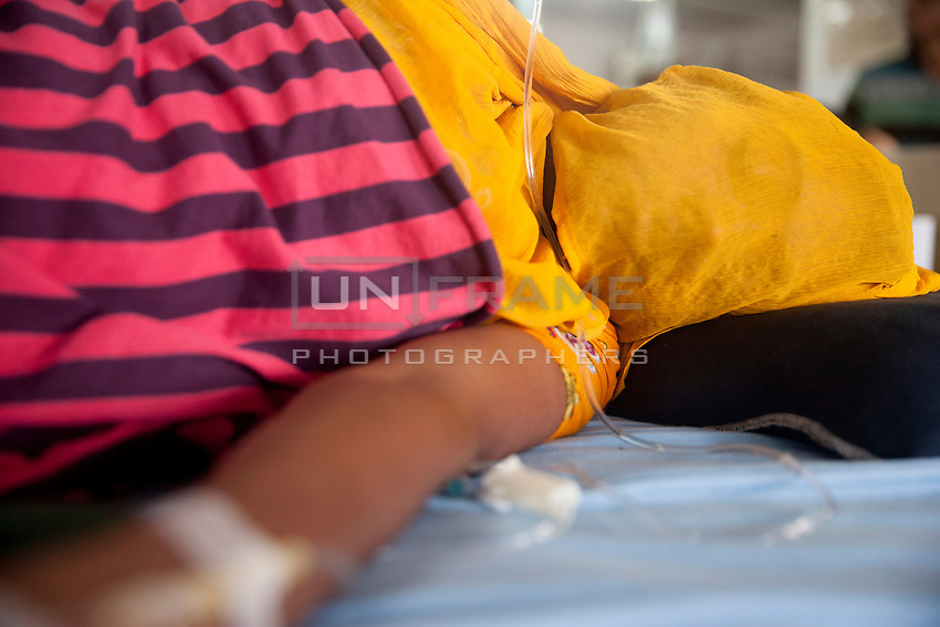 Bangladeshi garments Workers lay weary on Tuba Group's garments factory, the fifth day of their hunger strike over outstanding three months salary and Eid bonuses. Dhaka, Bangladesh