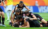 Players of team USA celebrate during the FIFA Women's World Cup at the FIFA Stadium in Dresden, Germany on July 10th, 2011.