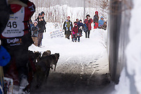 Ryne Olson runs under an overpass on the bike trail during the   Ceremonial Start of Iditarod 2012 in Anchorage, Alaska.