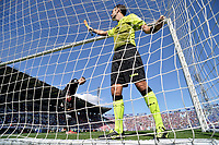 A linesman checks the integrity of the goal net during the Serie A football match between Bologna FC and SS Lazio at Renato Dall'Ara stadium in Bologna (Italy), October 3rd, 2021. Photo Andrea Staccioli / Insidefoto