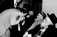 Chief Sephardic rabbi in town; Montreal Rabbi Mosche Suissa kisses the hand of Rabbi Mordechai Eliyahu; leader of the world's 3 million Sephardic Jews; who arrived in Metro yesterday. Eliyahu is flanked by Rabbi Amram Assayag; left; of Metro's Petah Tikva Anshe Castilla Congregation; and David Schluch; chief rabbi of Natanya; Israel.