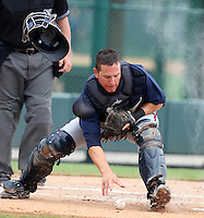 GCL Braves catcher Troy Snitker #2 fields a bunt during a game against the GCL Pirates at Disney Wide World of Sports on June 25, 2011 in Kissimmee, Florida.  The Pirates defeated the Braves 5-4 in ten innings.  (Mike Janes/Four Seam Images)