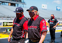 Jul 11, 2020; Clermont, Indiana, USA; Bobby Lagana (left) and Richard Hogan crew chief for NHRA top fuel driver Steve Torrence during qualifying for the E3 Spark Plugs Nationals at Lucas Oil Raceway. This is the first race back for NHRA since the start of the COVID-19 global pandemic. Mandatory Credit: Mark J. Rebilas-USA TODAY Sports