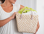 USA, Illinois, Metamora, Close-up of woman carrying laundry basket, mid section