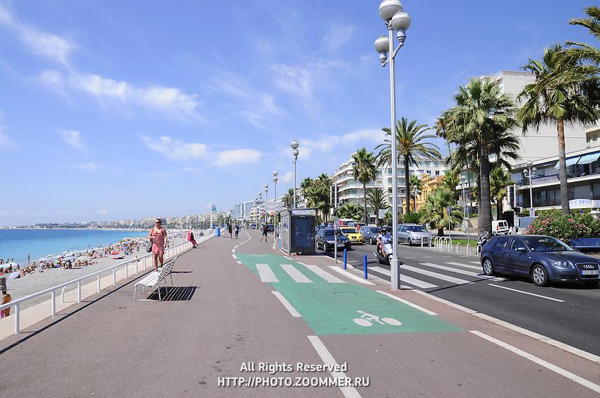 Cote de Azur public beach. Promenade in Nice, France.