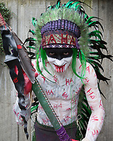Painted Ha Ha Indian Warrior with Green Feathered Headdress, Emerald City Comicon, Seattle, WA, USA.