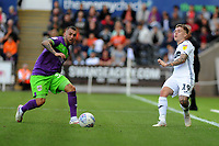 Jack Hunt of Bristol City vies for possession with Barrie McKay of Swansea City during the Sky Bet Championship match between Swansea City and Bristol City at the Liberty Stadium, Swansea, Wales, UK. Saturday 25 August 2018