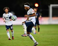 LAKE BUENA VISTA, FL - JULY 26: Derek Cornelius of Vancouver Whitecaps FC controls the ball during a game between Vancouver Whitecaps and Sporting Kansas City at ESPN Wide World of Sports on July 26, 2020 in Lake Buena Vista, Florida.